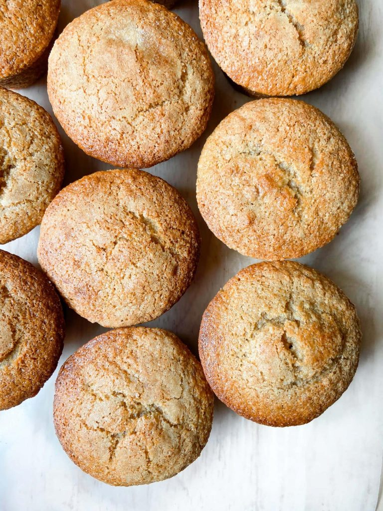 An array of baked banana protein muffins.