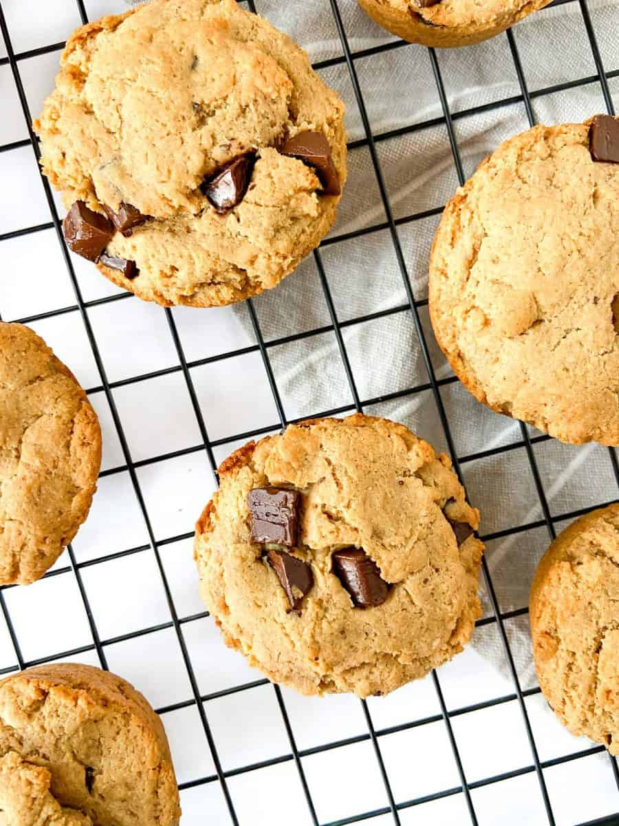 Peanut butter chocolate chunk muffins on a cooling rack.