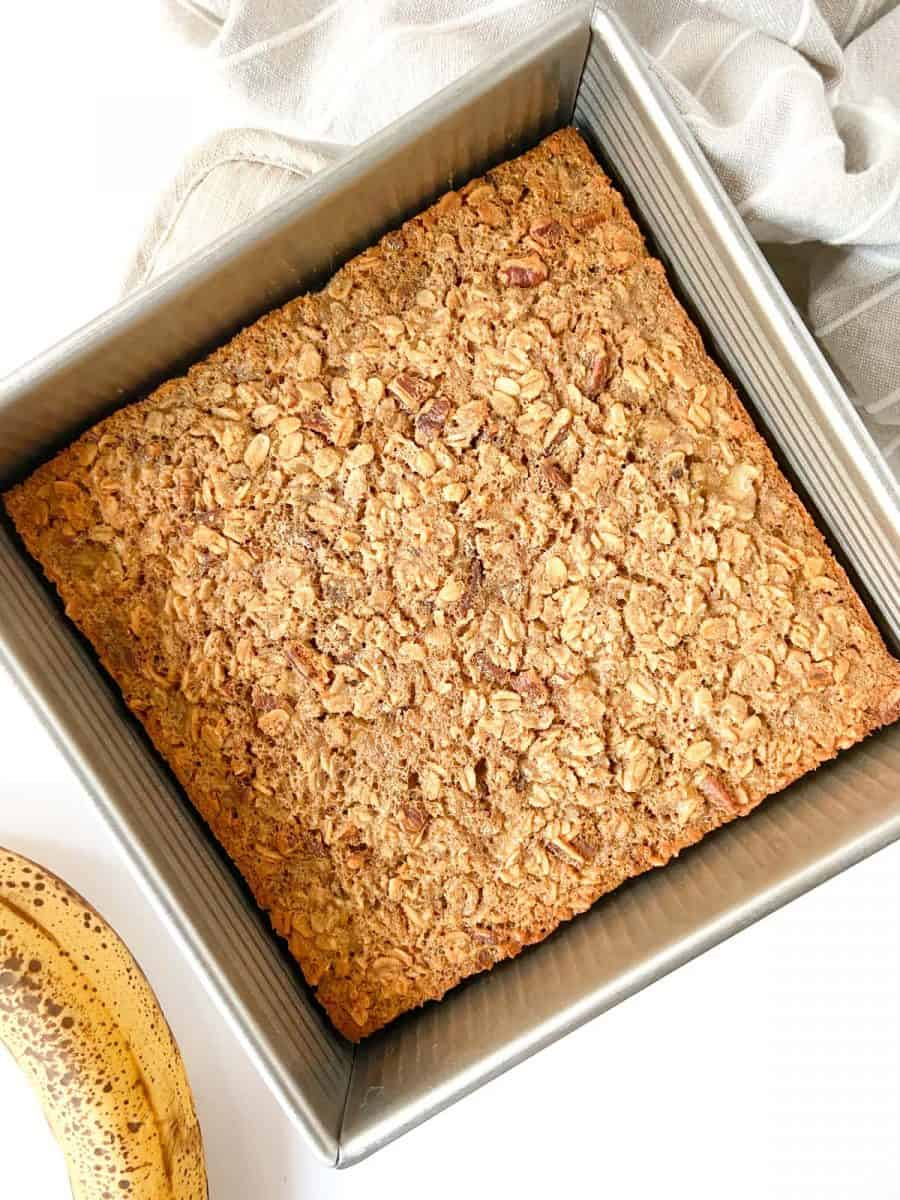 A tray of completed baked oatmeal, unsliced.