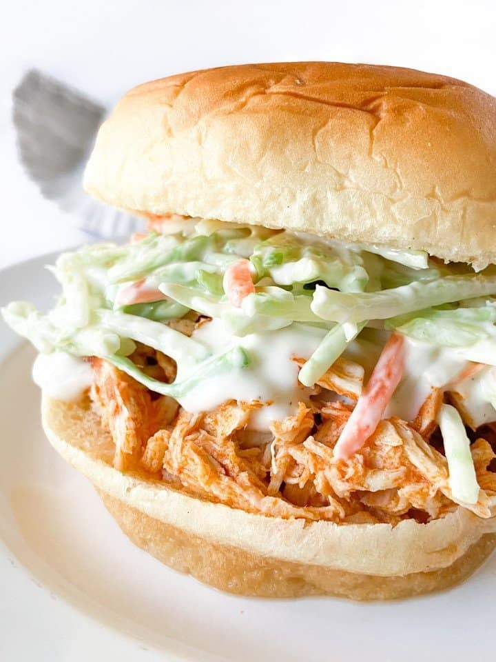 Slow-Cooker Buffalo Chicken on a bun with coleslaw