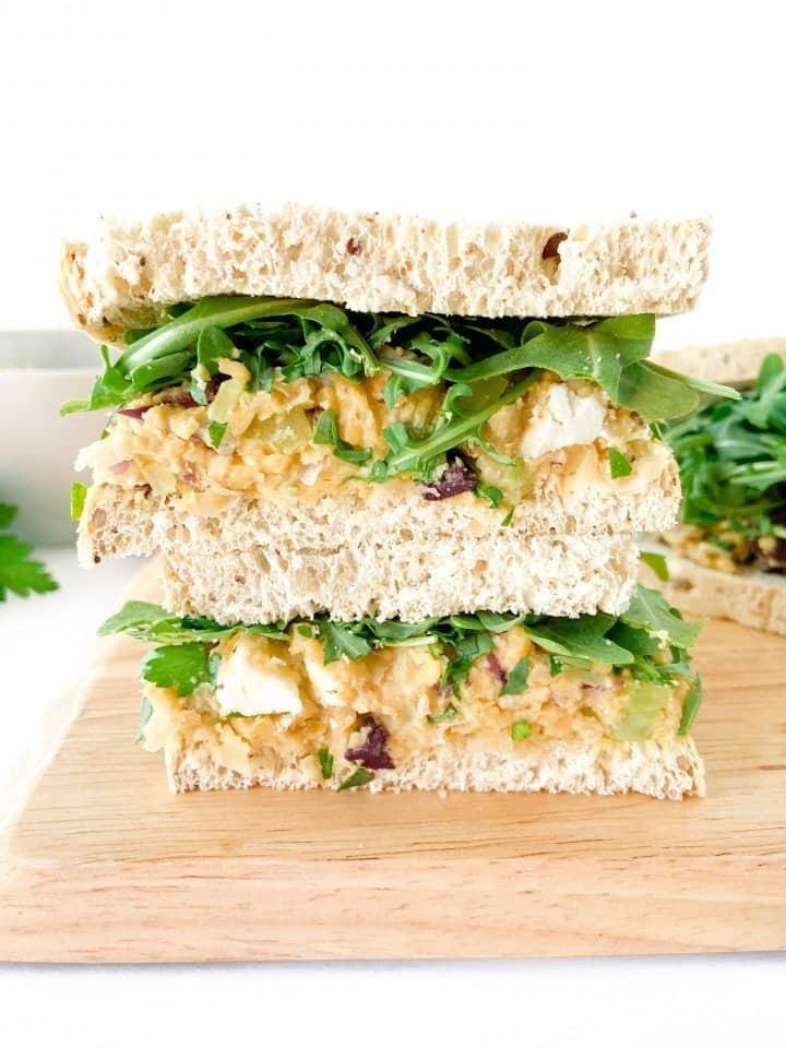 Mediterranean chickpea salad on toasted bread with arugula