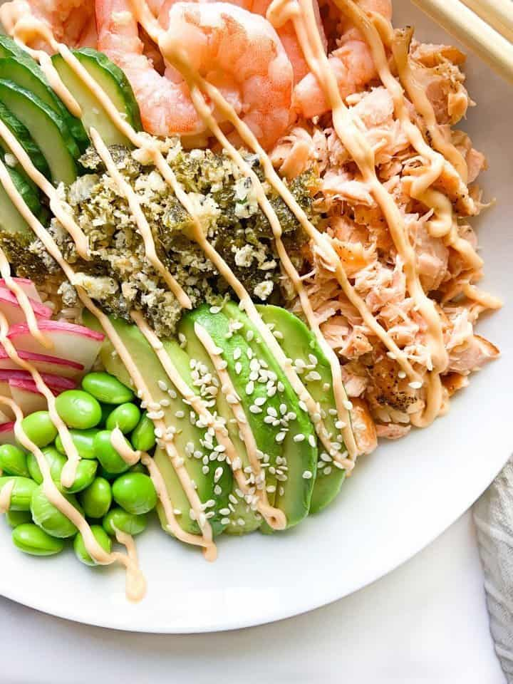 A Poke Bowl with cooked shrimp and salmon